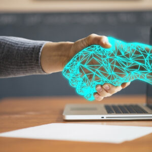 Artificial hand coming out of a computer screen to shake a human hand